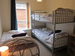 Comfortable triple room with large fitted wardrobe.