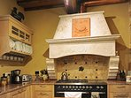 Travertine Hood over Commercial Six-burner Gas Stove