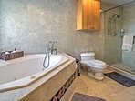 After an active day outdoors, enjoy soaking in the en suite master bathroom's bathtub.