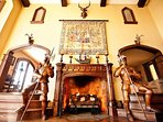 Life size hand-carved wooden knights flank each side of the Grand Fireplace.