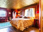 The Royal Bedroom features a comfortable queen bed fit for a King & Queen.