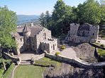 Aerial drone photo of Highlands Castle and The Castle Cottage.