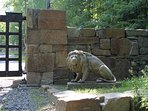 Life-size lion watches over the driveway entry gates.