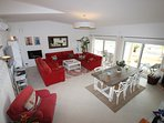 spacious living area with large patio doors to terraces with lovely sea views