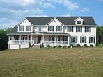 House is located only 1 mile from town but is situated on 60 acres