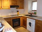 The well equipped U-shaped kitchen