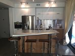 The kitchen features premium appliances as well as complimentary beer and breakfast items.