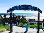 Bohemian Cabopino beach with Andy's bar