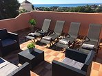 Stunning views from the roof top solarium with dining table and BBQ