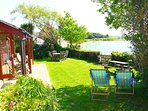The Boathouse Garden, private, stunning views and hot tub overlooking the water and sunsets