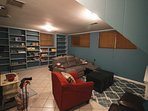 Lower level den has a recliner sofa, 55' TV, Netflix, HBO, games, books & a wood burning stove