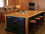 One of two kitchen islands with 'bar-side' seating.