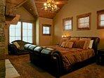 Grand master bedroom on upper level