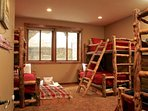 Bunk room on lower level with 3 sets Twin/Full bunks and two pullout trundles