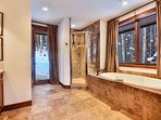 Master bathroom with jetted tub, shower and walk out access to outdoor hot tub.