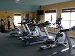 Community exercise room with elliptic machines and treadmills, and weights