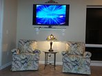 This condo has a 65' smart, flat screen television in the living room with seating for 10 guests.