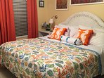 Comfortable master king sized bed.  Drapes can be closed for room darkening.