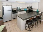 Fully equipped kitchen with breakfast bar with seating for 3