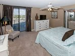 Master bedroom with double dresser and flat screen TV