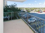 Private balcony overlooking front of building and parking lot