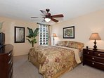 Master BR with king sized bed, HDTV, and private bathroom