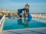 Piscina e scivolo spiaggia convenzionata 'Oasis de la playa'