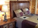 GUEST BED ROOM IS ON THE MAIN FLOOR WITH A QUEEN SIZE BED, HDTV