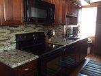 3rd floor kitchen - granite counter tops with cherry cabinets