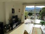 lounge with far reaching mountain views .