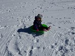Sledding the hill at the Country Club