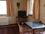 Dining area within lounge - Tv with inbuilt dvd player - free dvds for hire at main house