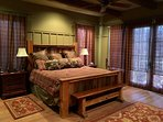 Master suite with King bed and private deck