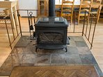 Wood Stove warms up both the kitchen and living room