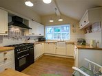 Kitchen is large and airy with full sized appliances and range cooker