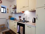 Fully fitted kitchen, complete with washing machine, oven, 4 ring gas hob, fridge/freezer etc.