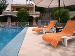 Sunny terrace around the heated private pool of Villa Alegria.