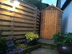Garden with new shed and plants blossoming!