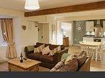 Open plan kitchen/diner/living room with log burner