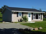 Clean airy cottage with private parking