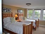 Middle bedroom on the second floor with twin beds