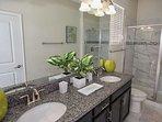 En-Suite to Downstairs Queen w/Double Sinks, Walk In Shower & Pool Access