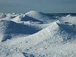 snow volcanoes in winter line the beach