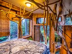 Queen loft at the top of the treehouse looking out at the secluded forest