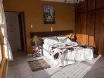 Main bedroom sleeps two with walk-in bathroom