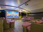 Upper terrace with soft furniture and projector screen