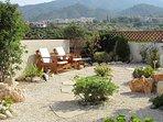 Rear Mediterranean garden with seating
