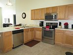 Fully equipped gourmet kitchen, with upgraded stainless steel appliances.
