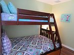Bunk bed features a twin on the top, a full size bed and twin in the trundle.