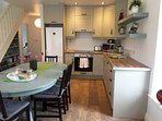 Modern and comfortable kitchen with all necessary appliances for a pleasurable stay.